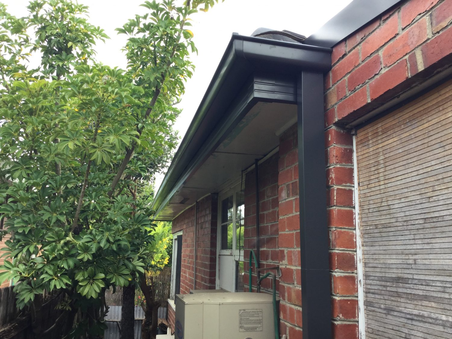 Gutter Replacement on a red brick house, Newtown